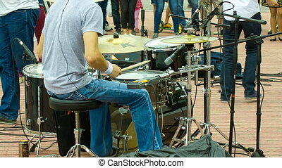 Drummer plays at the concert