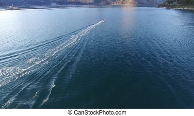 Speed Dinghy at high speed sailing on the sea. Kotor Bay in...