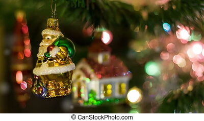 Santa Claus toy rotates on the New Year Tree with symbol of...
