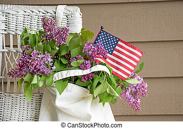 flag and lilacs in sack - American flag and lilac bouquet in...