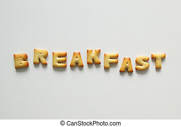 An inscription from the cookies on the white background. Text – breakfast.