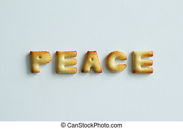 An inscription from the cookies on the white background. Text – peace.