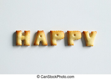 An inscription from the cookies on the white background. Text – happy.