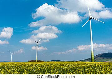 Wind engines in fields of rapeseed seen in Germany