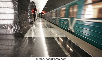 A subway train departs from station - A subway train departs...