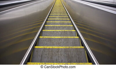 Downward movement standing on an empty escalator - The...