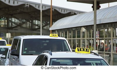 The queue of taxis outside the airport - The queue of the...