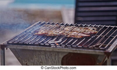 Meat Piece Roasts on Fire on Metal Barbecue Grid - meat...
