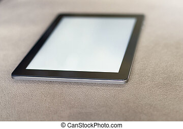 Digital tablet with empty screen.