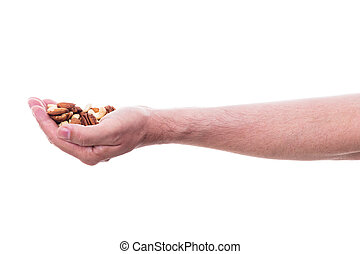 male hand is holding various nuts, isolated in front of...