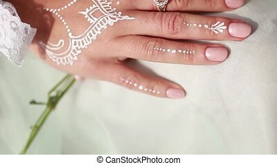Hand and arm painted with henna. Close-up. Wedding...