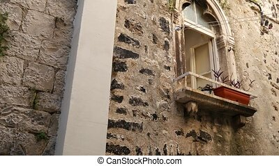 Balcony with columns in an old house. Balkan architecture....