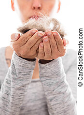 woman with pet hair allergy is holding some hairs in her...
