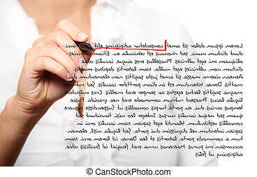 Female hand correcting a composition - A picture of a female...