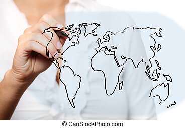 Female hand drawing a world map
