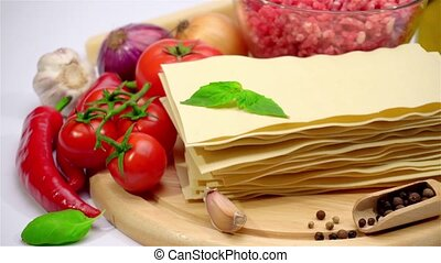 uncooked lasagna pasta sheets and vegetables