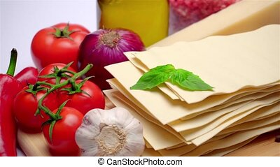 uncooked lasagna pasta sheets and vegetables - dried...