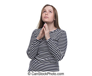 Praying young woman in striped dress on white background