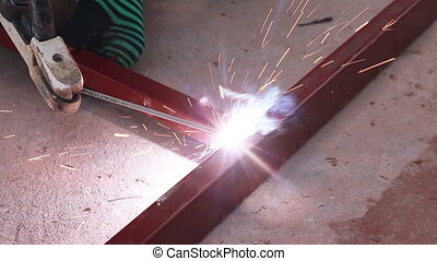 Welder at work in metal industry and build structure
