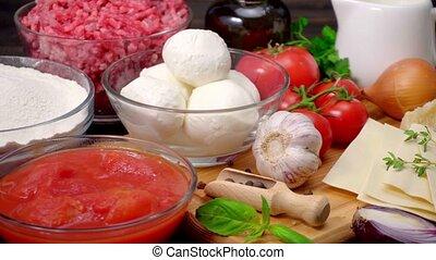 lasagna ingridients on wooden table - lasagna ingridients on...