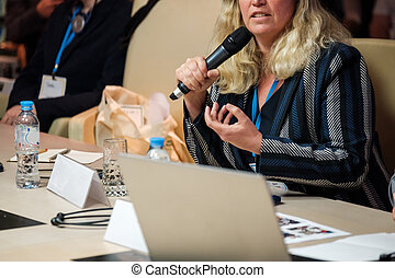 Businessman talking at conference - Businesswoman talking at...