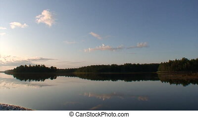Calm water on background of coast White Sea.