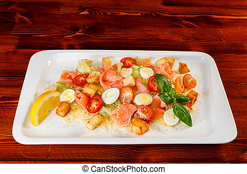 salad of romaine lettuce with smocked salmon, quail eggs, croutons, cherry tomatoes with caesar dressing