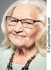 optics for old people - Portrait of a modern senior woman...