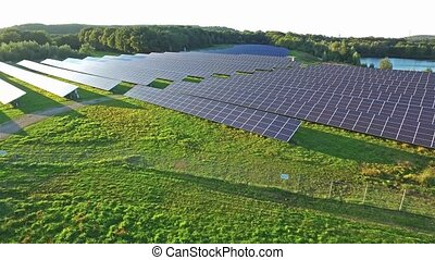 Aerial shot of solar power plant with beautiful lake in the middle