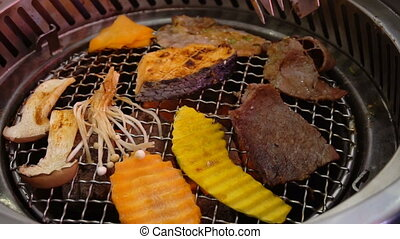Mixed roasted meat and vegetable barbecue grill.