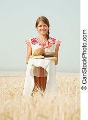 Girl  with bread at field