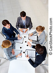 Meeting - Above view of friendly workteam discussing new...