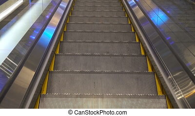 moving escalator up in a public area. hd footage 1080