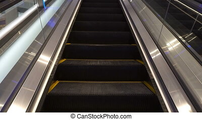 moving escalator up in a public area.