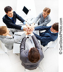 Partnership - Above view of business people with their hands...