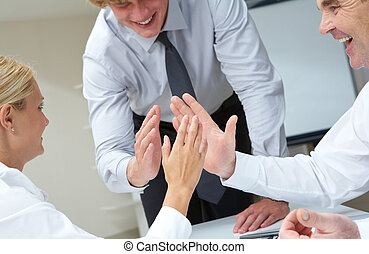 Support - Image of business people with their palms opposite...