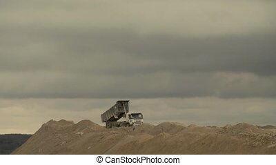 Truck unloading in a quarry.