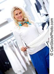 Happy shopper - Portrait of pretty woman choosing new...
