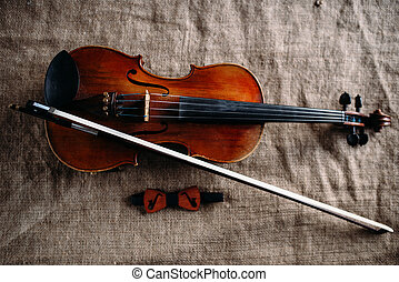 Violin, fiddlestick and bowtie, canvas background - Violin,...