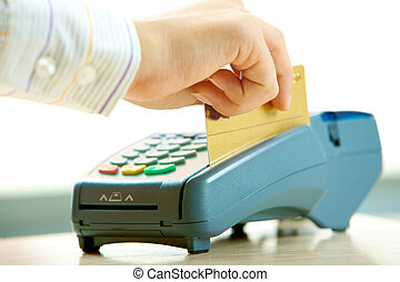 Paying by credit card - Close-up of human hand putting...
