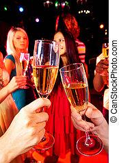 Birthday toast - Image of toasting couple clinking glasses...