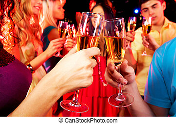 Clinking glasses with champagne - Image of toasting couple...