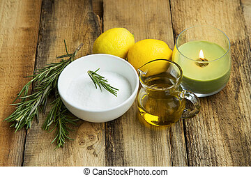 Natural homemade skincare products with baking soda, lemon, rosemary herb, olive oil, organic skincare