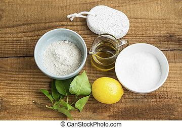 Natural homemade skincare ingredients with clay,baking soda, lemon, pumice stone, olive oil, organic skincare still life
