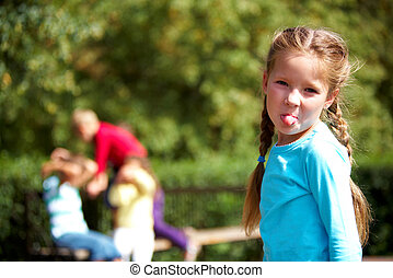 Grimace - Portrait of funny girl looking at camera and...