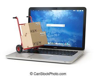 E-commerce, online shopping and delivery concept. Hand truck and cardboard boxes on PC laptop keyboard.