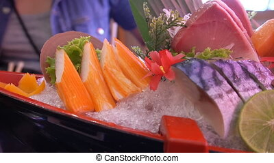 Uncooked fresh salmon and red tuna fish and saba and squid...
