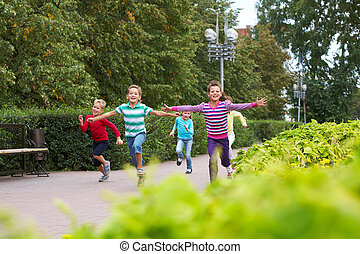 Activity - Portrait of happy friends running in park