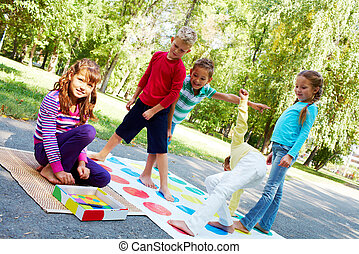 Outdoor game - Portrait of happy friends playing outdoor...