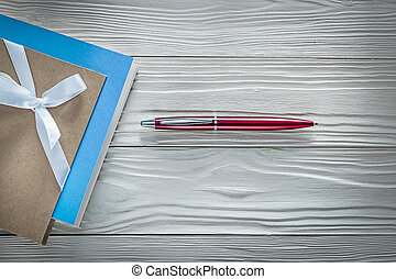 Vintage notepads red biro pen on wooden board horizontal...